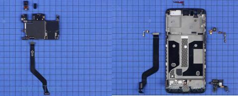 一加5智能手机主板上的光线距离传感器上盖有橡胶套保护,内支撑上集成了侧键软板、振动器、MEMS麦克风软板等